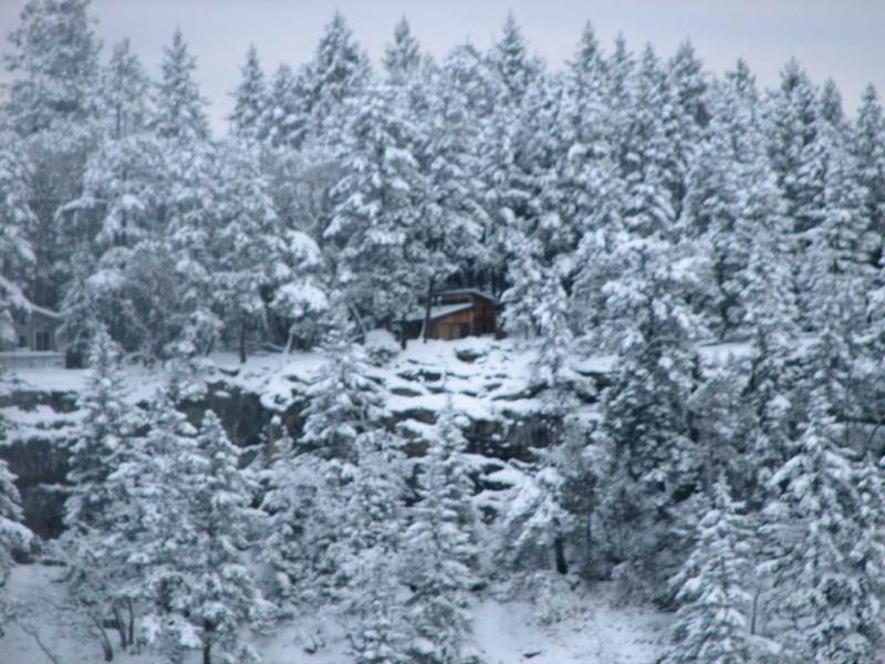 Cabin in snow from ocean
